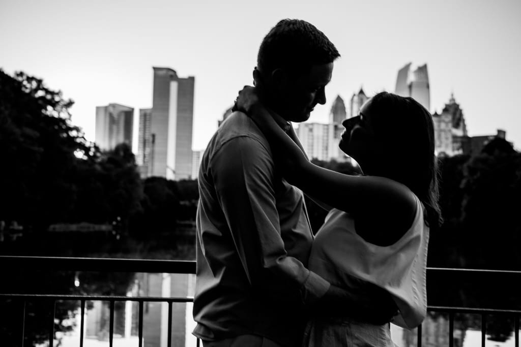 A couple almost silhouette on teh dock at Piedmont park for an engagement session.