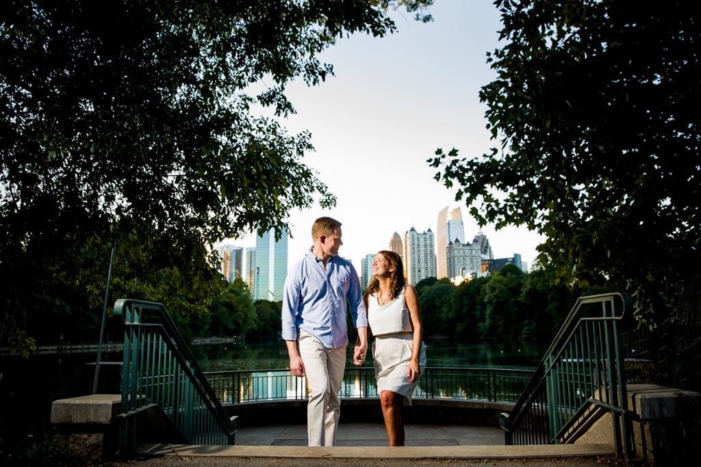 A couple walking on the stairs at piedmont park for an engagement session.