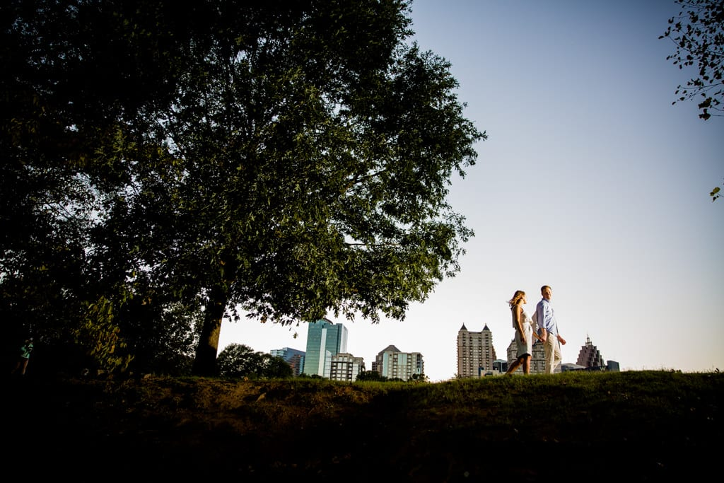 walking through piedmont park during an engagement session.