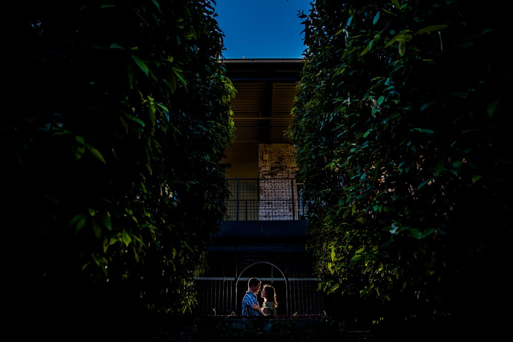 An engagement session at west midtown provisions district in atlanta with trees and interesting light.