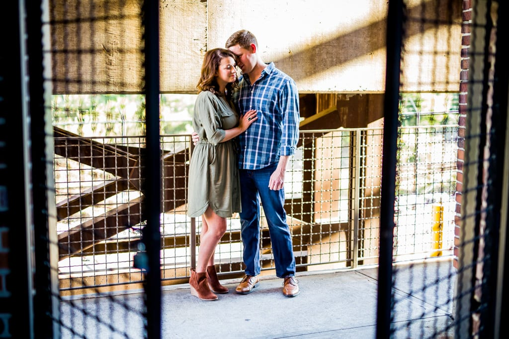 An engagement session at west midtown provisions district in atlanta with interesting light.
