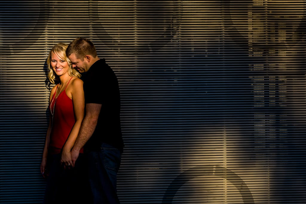A spotlight of sunlight landing on a couple during their downtown atlanta engagement session.