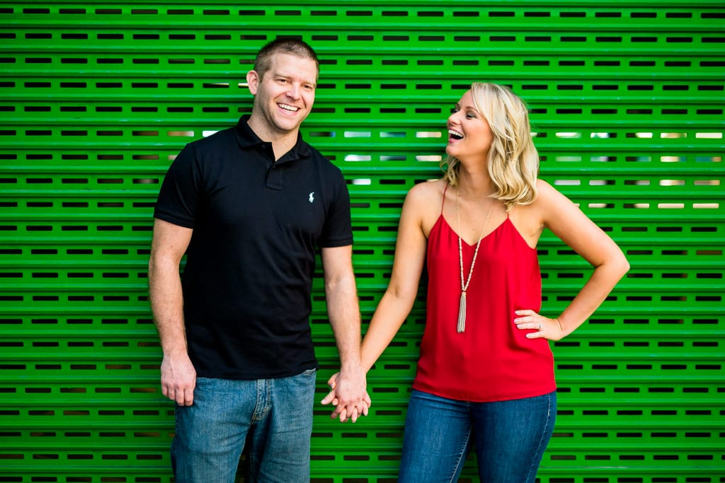 Two people laughing at their downtown atlanta engagement session.