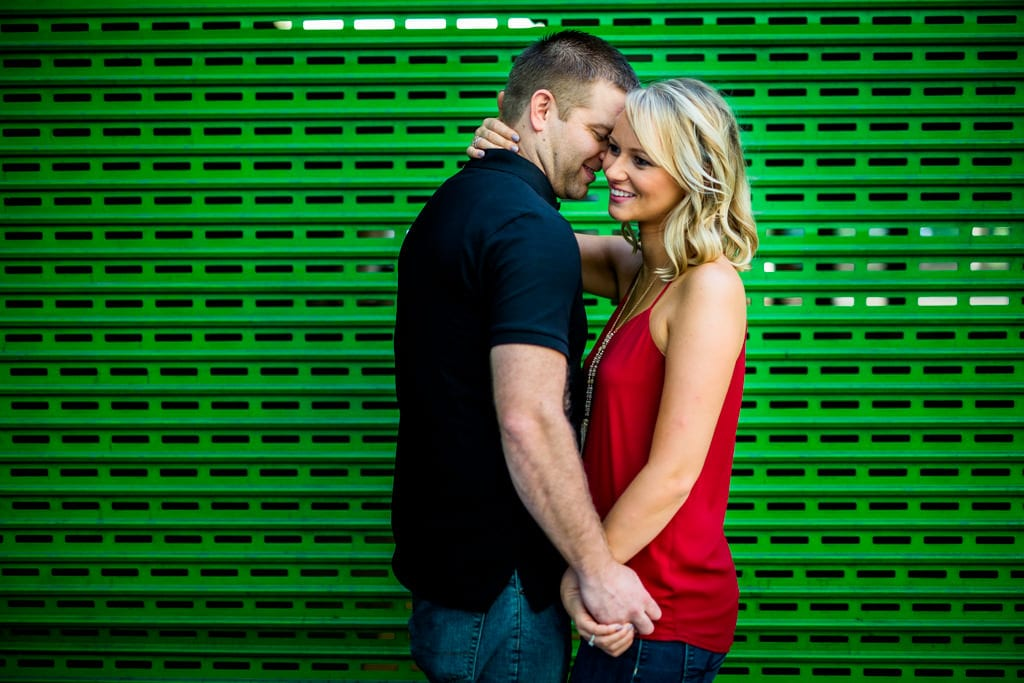 A couple posing for their downtown atlanta engagement session.
