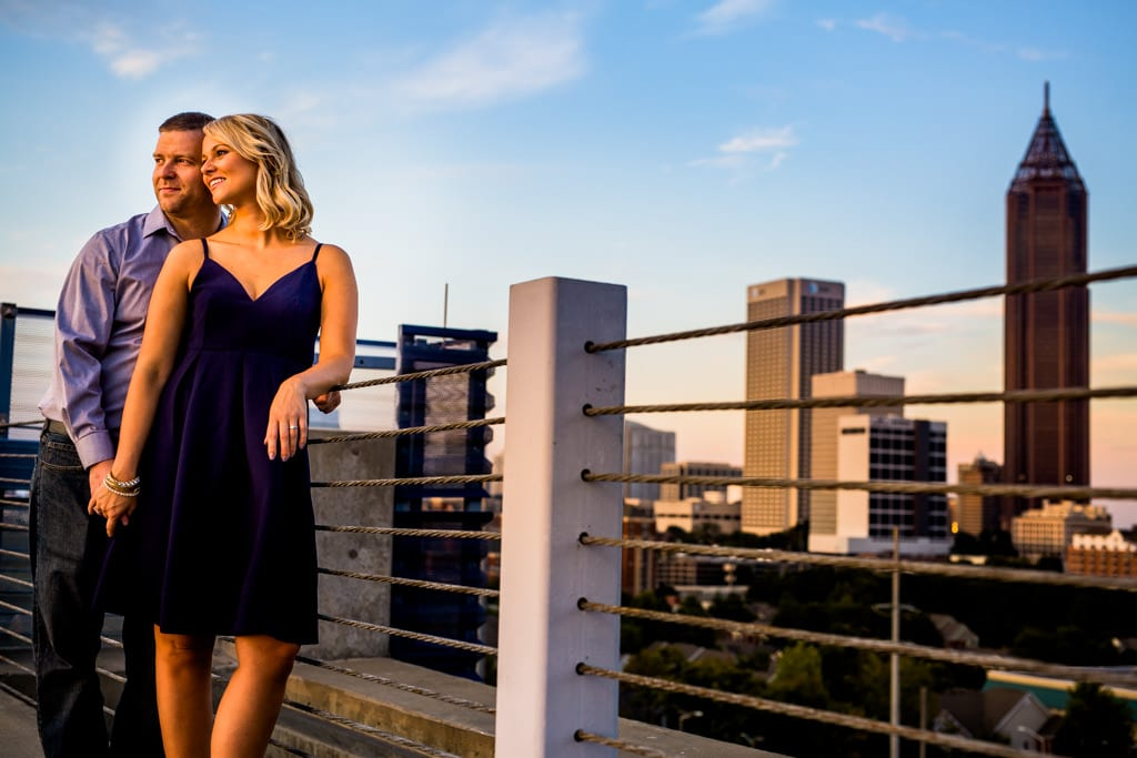 The sun setting on a dancing couple with the Atlanta skyline for an Atlanta engagement session.