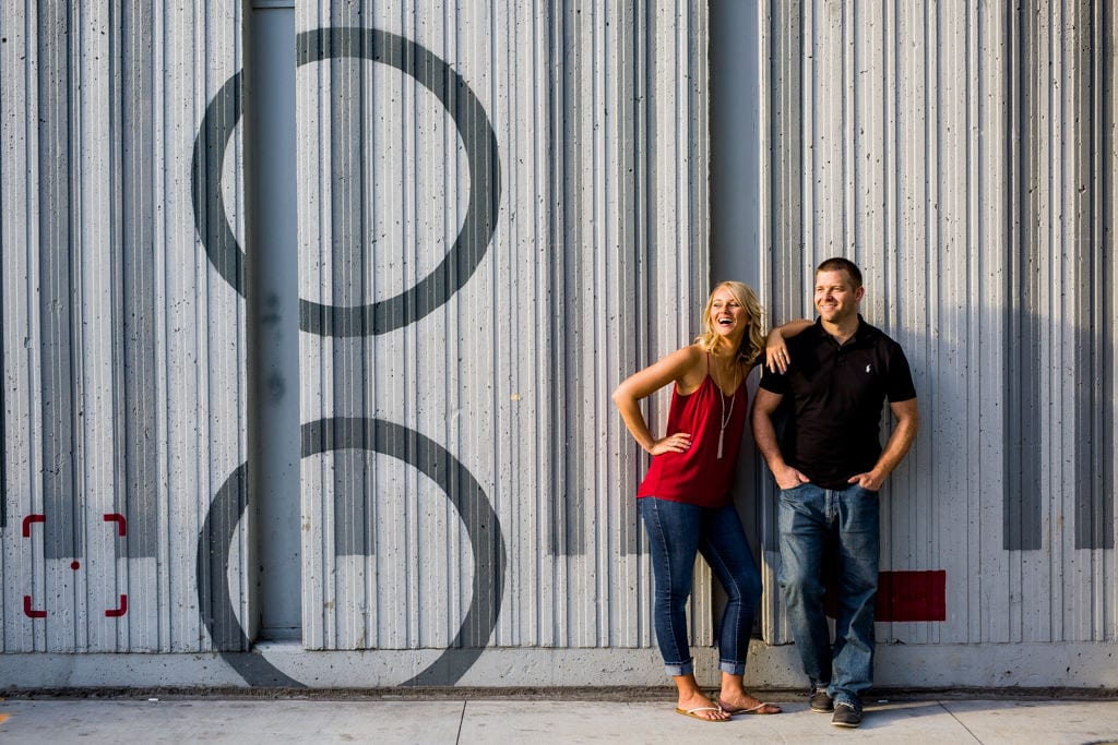 Two people smile for their downtown atlanta engagement session.