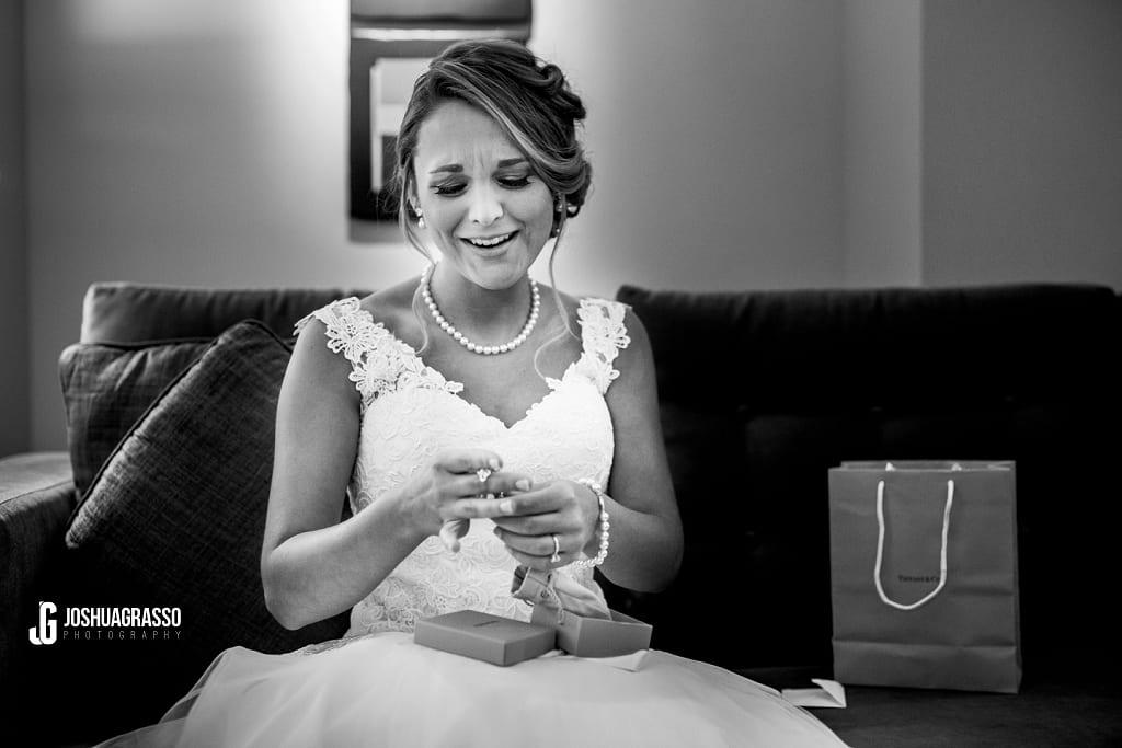 bride loving her groomsmen gift