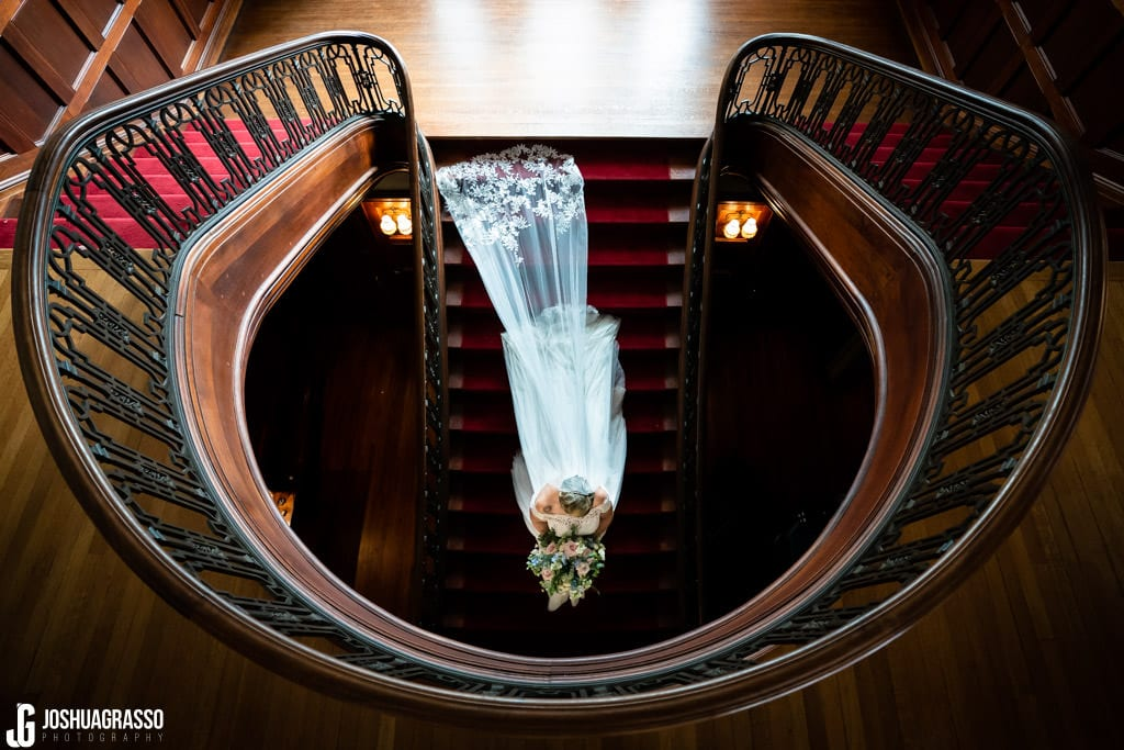 Bride walking down the stairs at callanwolde fine arts center