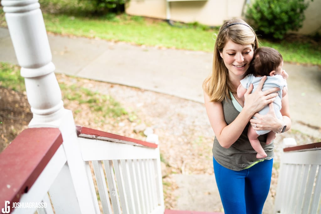 mother walking with baby during atlanta family documentary lifestyle portraits