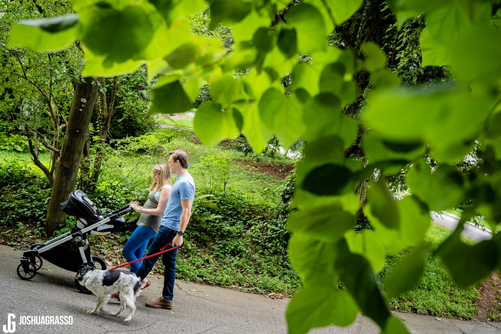 Walking with new baby during atlanta family documentary lifestyle portraits