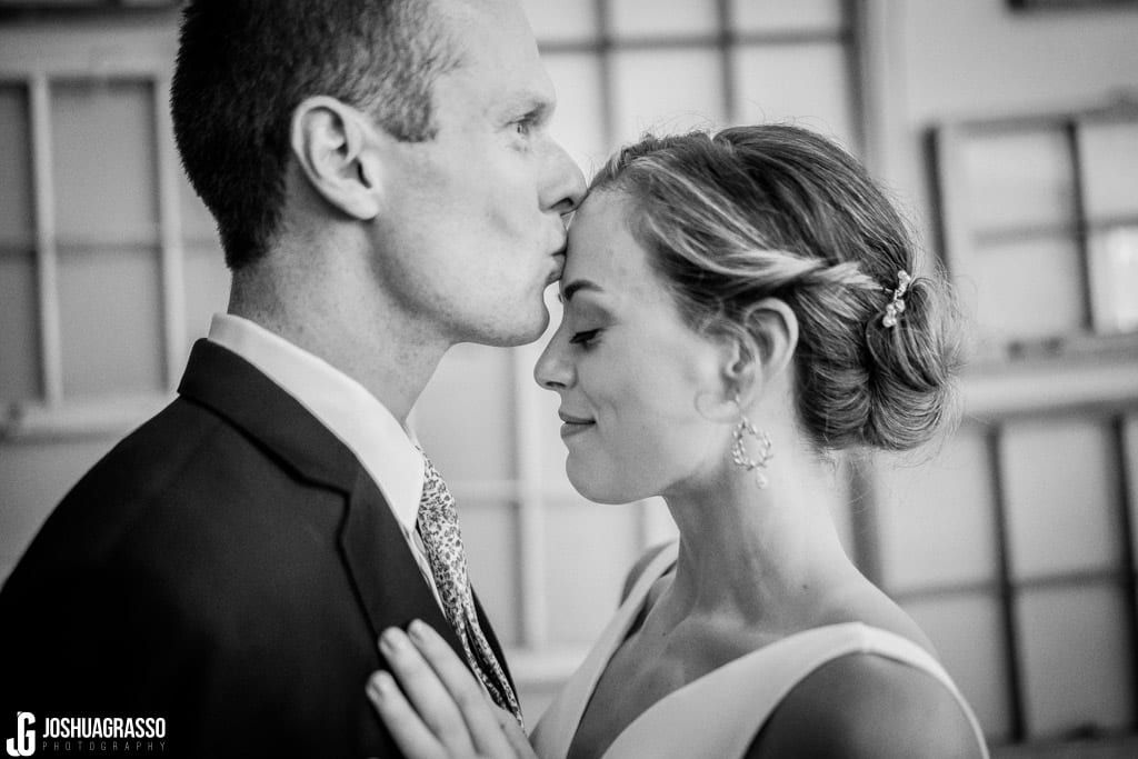 Bride and groom kiss portrait at Monday Night Garage Wedding