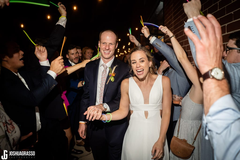 Bride and groom exit at Monday Night Garage Wedding