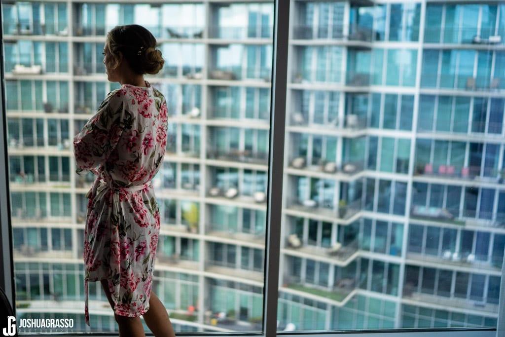 Bride overlooking skyline getting ready at Loews hotel in atlanta