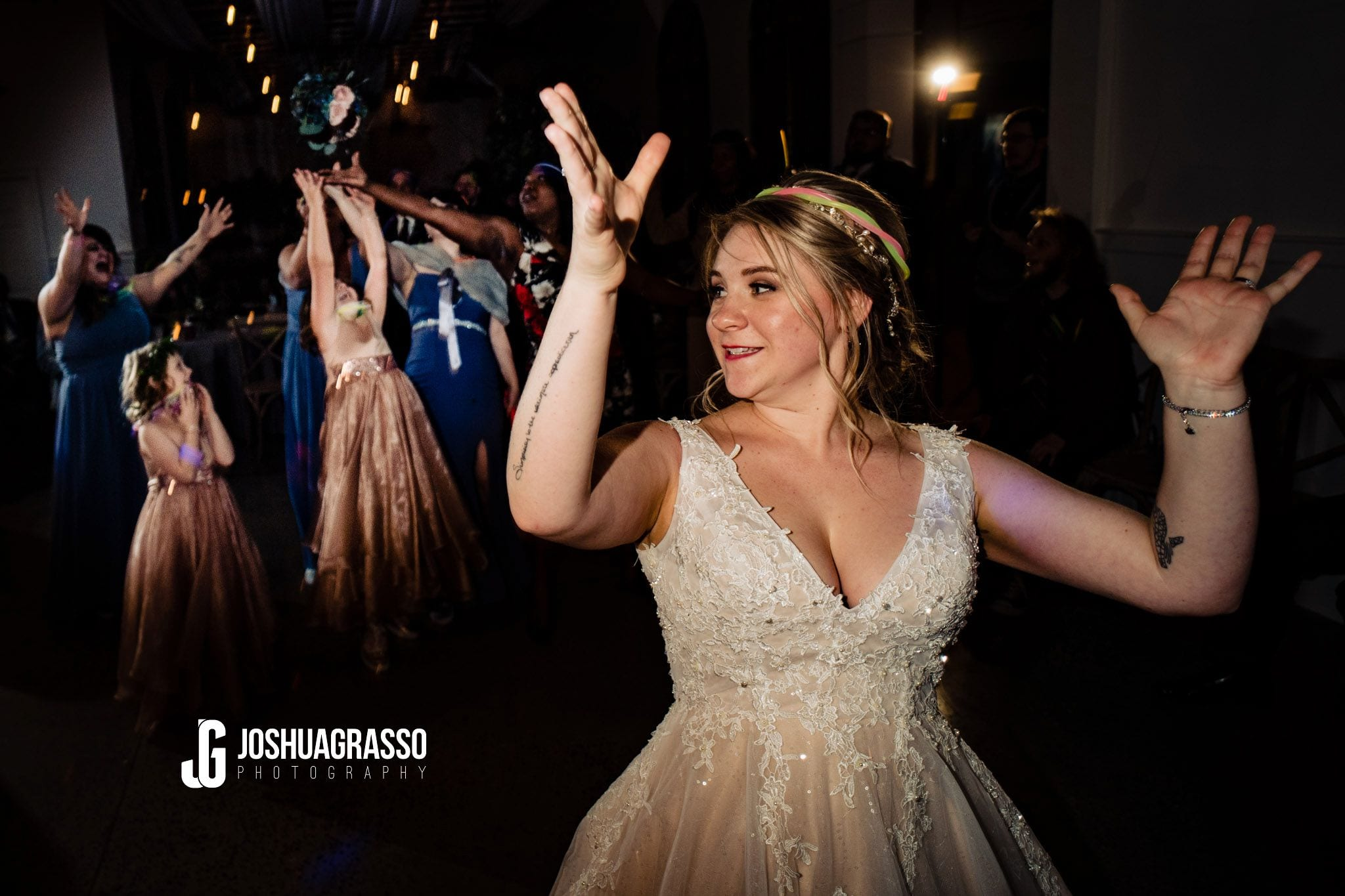 Bride tossing her boutique during the wedding reception at Walnut Hill Farm wedding venue.
