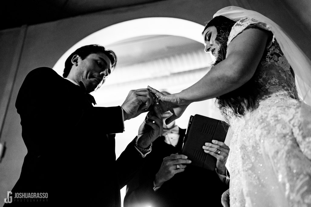 Bride and Groom exchange rings during wedding ceremony at Montaluce winery wedding venue.