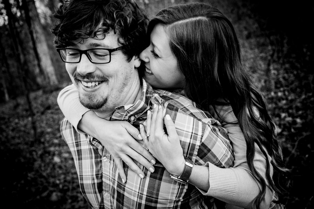 couple laughing together at lower oconee park for their athens engagment session