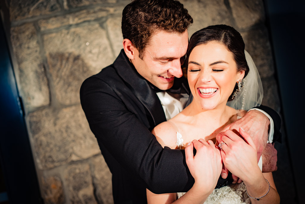 Couple laughs during portraits at greystone wedding.
