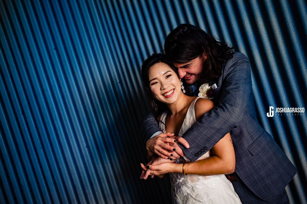 bride and groom portrait at king plow art center courtyard