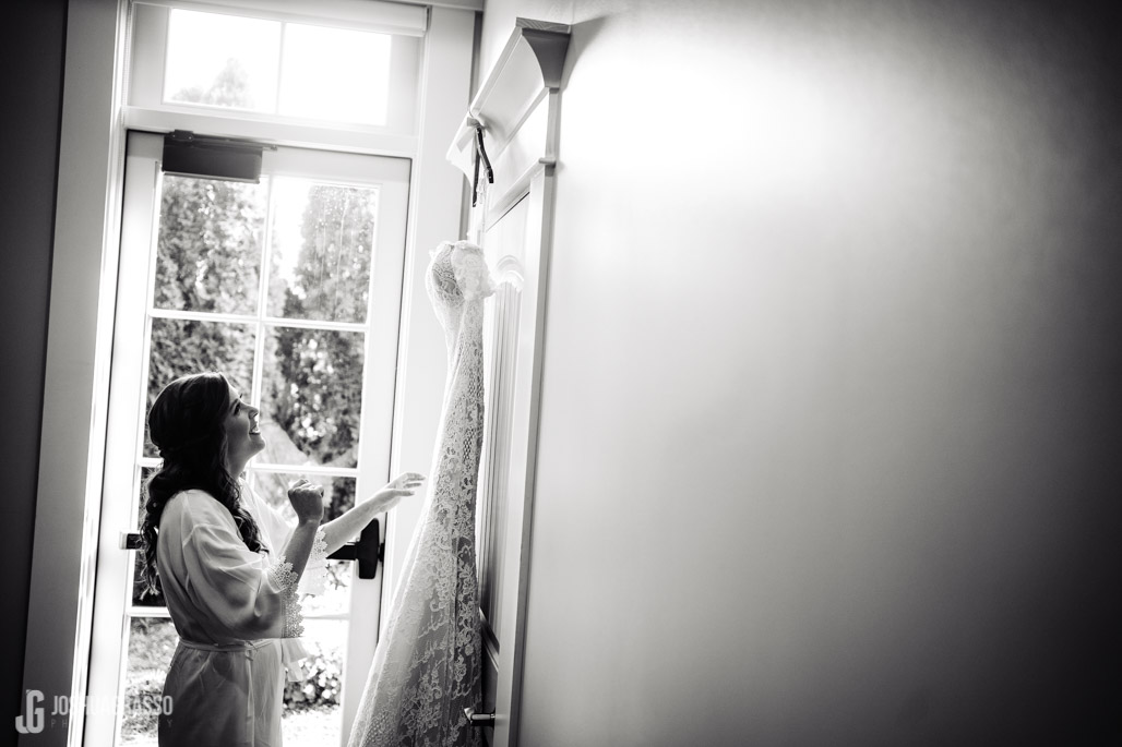 Yonah mountain wedding bride looking at dress